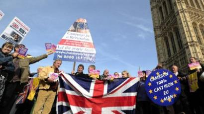 London : United Kingdom Independence Party (UKIP) supporters hold Union Jack flags and placards as they take part in a demonstration outside the Houses of Parliament in central London. (AFP PHOTO/ CARL COURT)
