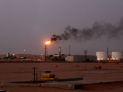 "A flame from a Saudi Aramco (the national oil company) oil installation known as ""Pump 3"" burns brightly during sunset in the Saudi Arabian desert near the oil-rich area Al-Khurais (AFP Photo / Marwan Naamani)"