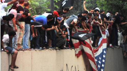 Egyptian protesters tear down the US flag at the US embassy in Cairo on September 11, 2012.(AFP Photo / STR)