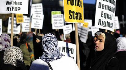 New York: Members of the Muslim community stage a rally prior to performing Friday prayers on Foley Square in support of Occupy Wall Street against police brutality and surveillance in New York, November 18, 2011. (AFP Photo/Emmanuel Dunand)