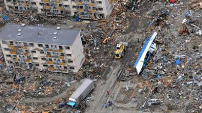 This handout photo taken on March 14, 2011 and received on March 19, 2011 by the US Air Force shows an US Air Force search and rescue team in an HH-60 G Pave Hawk helicopter surveying the earthquake and tsunami damage as it flies over Sendai in Miyagi prefecture (AFP Photo / HO / US Air Force / Airman 1st Class Katrina R. Menchaca)