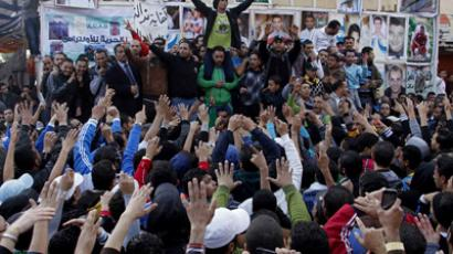 Egyptian protesters and fans of al-Masry football club take part in a demonstration in front of the prison in the Egyptian Suez Canal city of Port Said on January 25, 2013, calling for the prisoners who are suspected of killing 74 fans of al-Ahly club during a football match in February 2012, not to be transferred to Cairo to attend their trial. (AFP Photo)