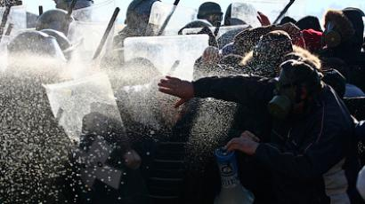 Kosovo Force (KFOR) soldiers from Germany and Austria spray tear gas towards Kosovo Serbs during clashes in the village of Jagnjenica near the town of Zubin Potok November 28, 2011 (Reuters / Bojan Slavkovic)
