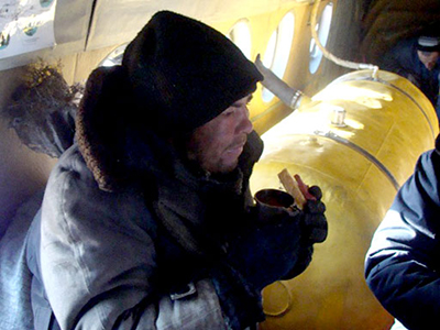Aleksandr Abdulaev is one of two people discovered by an emergency service helicopter patrol on November 28 in Russia's Yakutia Republic. (Photo courtesy of the EMERCOM in Yakutia Republic)