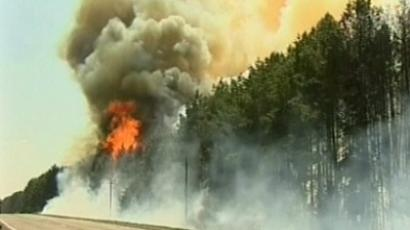 Two dead, tens of thousands evacuated as worst fire in Colorado history spreads