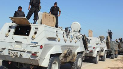 Egyptian security forces stand by their Armoured Personell Carriers ahead of a military operation in the northern Sinai peninsula on August 08, 2012 (AFP Photo / Stringer)