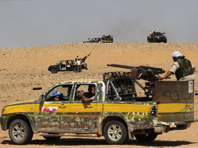 Rebels assault Gaddafi's hometown