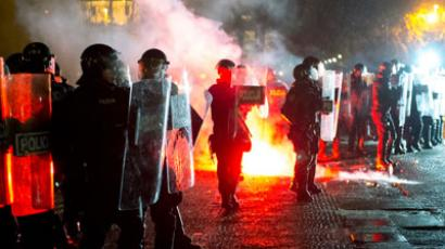 Police face protesters during a protest against the Slovenian government in Ljubljana, on November 30, 2012.(AFP Photo / Vinko Stojnsek)