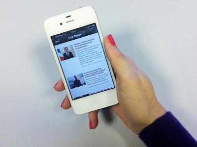 A smartphone user browses RT news headlines using the dedicated app