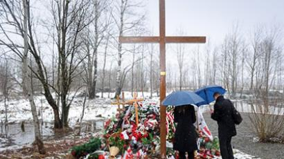 Smolensk: Grieving relatives of the victims of the April 2010 crash of a Polish presidential jet in which president Lech Kaczynski and all 95 other passengers were killed attend a mass during a memorial service on the Smolensk airdrome, the site of the disaster, on April 9, 2011. (AFP Photo / Natalia Kolesnikova)