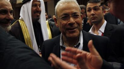 Syrian National Council President Burhan Ghalioun (C) is greeted by council members during a news conference after their meeting in Istanbul March 27, 2012. (Reuters / Murad Sezer)