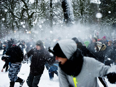 Young people participate in the big snowball fight that is organized through social media at the Valkenberg Park in Breda, The Netherlands, on January 15, 2013.(AFP Photo / Robin Utrecht)