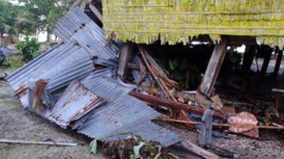 This handout photo taken on February 7, 2013 and released by World Vision shows damage to homes in the village of Louva, caused by a tsunami in the Santa Cruz Islands region of the Solomons Islands. (AFP Photo/World Vision)