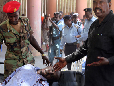 Suicide blast in Somali theater targets PM, officials - 10 dead
