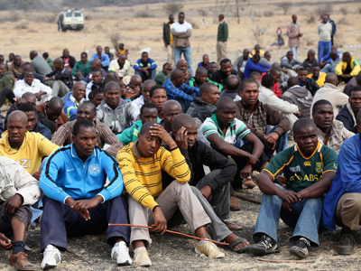Mine workers gather while on strike near the scene of a shooting at Marikana, in the north western province August 27, 2012 (Reuters / Mike Hutchings)