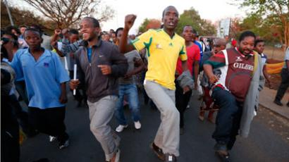 Miners and their supporters dance after being released outside the court in Ga Rankuwa, near Pretoria.(REUTERS / Mike Hutchings)