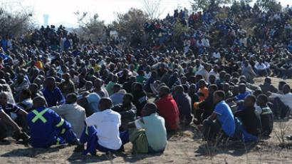 Miners stage a sit-in close to the village of Rustenburg on August 14, 2012 near a platinum mine run by leading producer Lonmin, where nine people were killed in clashes between rival unions in South Africa, the world's largest supplier of the precious metal (AFP Photo / STR)