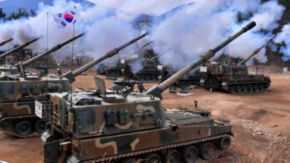 South Korean army K9 Thunder 155mm self-propelled Howitzers fire during a live-fire drill in Pocheon, 65 kms northeast of Seoul (AFP Photo/Dong-a Ilbo)