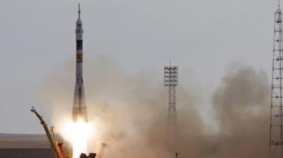 The Soyuz TMA-05M spacecraft carrying the International Space Station (ISS) crew of Russian cosmonaut Yuri Malenchenko, Japanese astronaut Akihiko Hoshide and U.S. astronaut Sunita Williams blasts off from its launch pad at Baikonur cosmodrome July 15, 2012. (Reuters/Shamil Zhumatov)