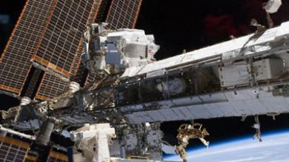 ISS team feeling gravity's pull after six-month mission