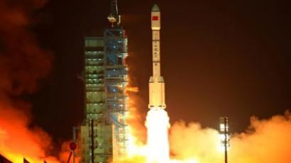 "Jiuquan: China's Long March 2F rocket carrying the Tiangong-1 module, or ""Heavenly Palace"", blasts off from the Jiuquan launch centre in Gansu province on September 29, 2011. (AFP Photo/STR/China Out)"