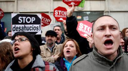 Anti-eviction activists from the Mortgage Victims' Platform (PAH) protest outside parliament during a vote to consider a people's legislative initiative for a new mortgage law, in Madrid, February 12, 2013 (Reuters / Javier Barbancho)