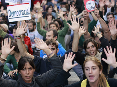 Protesters shout slogans during a demonstration outside Madrid's Parliament, September 26, 2012. (Reuters/Susana Vera)