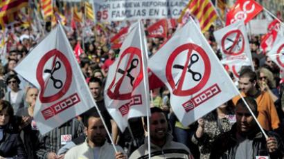 People take part in a protest march against the government new labour reform in Barcelona on March 11, 2012 (AFP Photo / Josep Lago)