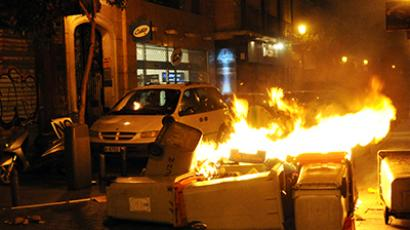 Spain, Madrid: Waste containers burn after a demonstration against the Spanish government's latest austerity measures in downtown Madrid on July 19, 2012 (AFP Photo / Dominique Faget)