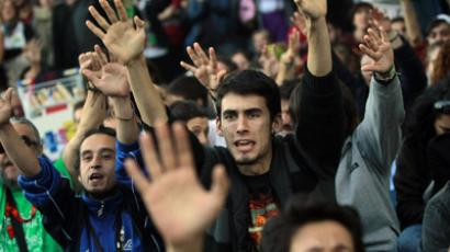 Demonstrators raise their arms during an assembly outside Madrid's Parliament October 23, 2012, as the debate for the 2013 budget goes on inside.(Reuters/Susana Vera)