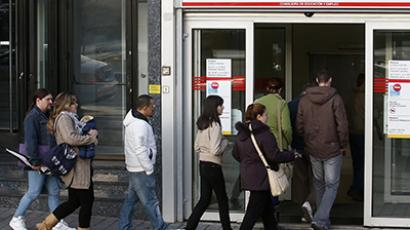 People enter a government-run employment office in Madrid (Reuters / Andrea Comas)
