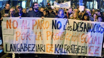 "Thousands of people hold a banner as they march through the Spanish Basque town of Barakaldo November 9, 2012. The protest was called after Amaia Egana, a 53 year-old woman committed suicide in Barakaldo on Friday after receiving official notice that she was to be evicted, according to local media. The banner reads, ""No To Unemployment. No To Evictions"". (Reuters/Vincent West)"