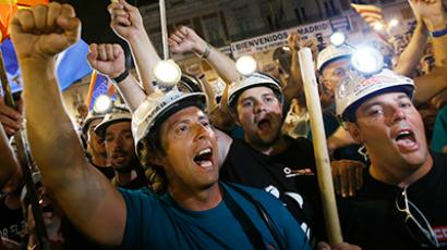 "Coal miners shout slogans in Madrid's Puerta del Sol at the end of their ""Marcha Negra"" (Black March) early July 11, 2012 (Reuters/Juan Medina)"
