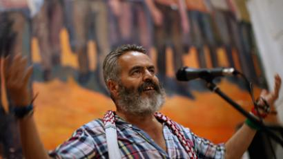 Marinaleda's Mayor and Izquierda Unida (IU) Parliamentarian Juan Manuel Sanchez Gordillo, 59, gestures as he speaks during a popular assembly in Marinaleda, southern Spain, August 15, 2012 (Reuters / Jon Nazca)