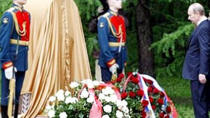 Russian Prime Minister Vladimir Putin, right, attends a ceremony to lay a corner stone for a war memorial, a replica of a destroyed memorial in Kutaisi, in Victory Park on Poklonnaya Hill on the eve of Victory Day in Moscow, Saturday, May 8, 2010