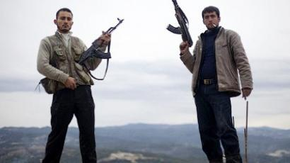 A portrait of two Free Syrian Army rebels posing with their rifles in Al-Shatouria village near to the Turkish border in northwest Syria, on March 16, 2012 (AFP Photo / Giogos Moutafis)