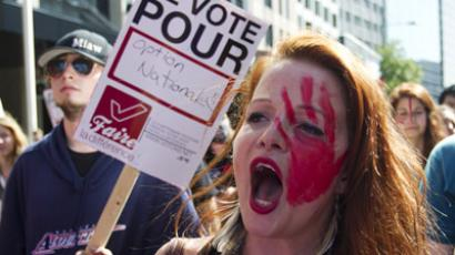 "A protester shouts slogans during a march against student tuition fee hikes in downtown Montreal, August 22, 2012. The sign reads: "" I vote for Option Nationale."" Option Nationale is a provincial political party in Quebec. (Reuters/Olivier Jean)"