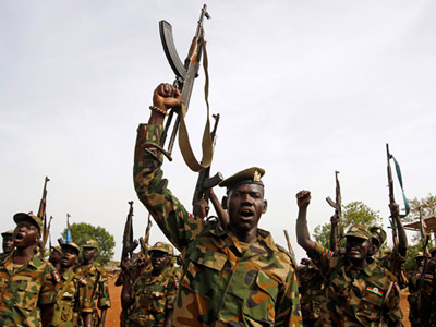 South Sudan's SPLA soldiers hold up their weapons as they shout at a military base in Bentiu April 22, 2012. (REUTERS/Goran Tomasevic)
