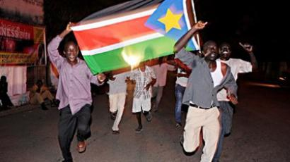 Residents of Juba in South Sudan celebrate in the streets the birth of their new nation on July 9, 2011 (AFP Photo / Roberto Schmidt)