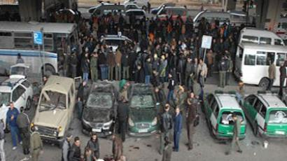 A handout picture from the official Syrian News Agency (SANA) shows onlookers gathering on January 6, 2012 at the site of a powerful explosion in the Midan neighbourhood in the heart of the capital Damascus (AFP Photo / HO / SANA)