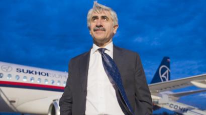 UAC chief Mikhail Pogosyan near a Sukhoi Superjet 100 (RIA Novosti / Sergey Guneev)