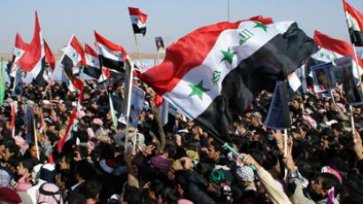 Iraqi Sunni Muslims wave the old flag of Iraq during an anti-government demonstration in Ramadi, 100 km (62 miles) west of Baghdad, December 26, 2012 (Reuters / Stringer Iraq)