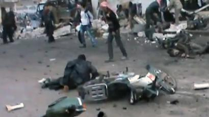 "Screenshot from youtube.com @Souria2011archives / Video titled ""Assad MIG Mass Murder of Bakery Bread Line in Halfaya 12-23-12"""