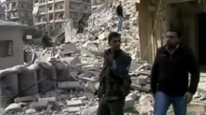 A video broadcast on Syrian state TV showed the collapsed floors of the targeted building in a government-controlled area of Aleppo. AP video