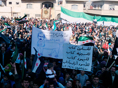 Demonstrators protesting against Syria's President Bashar al-Assad gather during a march through the streets after Friday prayers in Marat al Numan near Adlb December 2, 2011 (Reuters / Handout)