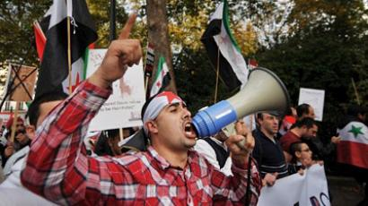 A protestor uses a megaphone during a demonstration against the regime of Syrian president Bashar al-Assad (AFP Photo / BEN STANSALL)