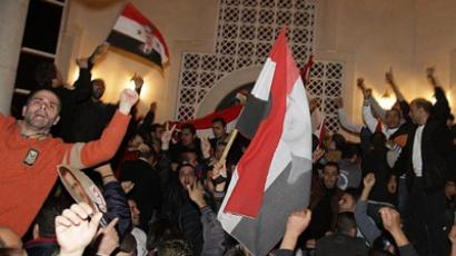 "Syrians protest outside the Qatari Embassy in Damascus on November 12, 2011, hours after a statement, read by Qatari Prime Minister Hamad bin Jassem Al-Thani, said the Arab League had decided ""to suspend Syrian delegations' activities in Arab League meetings"" and to implement ""economic and political sanctions"" against Damascus (AFP Photo / LOUAI BESHARA)"