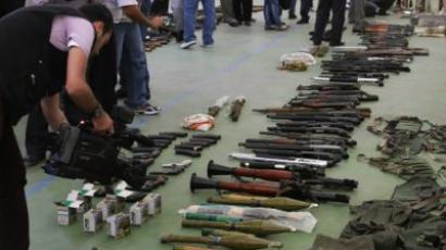 Weapons allegedly seized from armed dissidents in the city of Rastan in the central Homs province, about 180 kilometres from Damascus, on October 13, 2011. (AFP Photo/Louai Beshara)