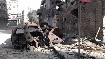 Buildings damaged by the government army, according to the opposition, are seen at Juret al-Shayah, in Homs April 10, 2012 (Reuters/Khaled Tellawi/Shaam News Network/Handout)