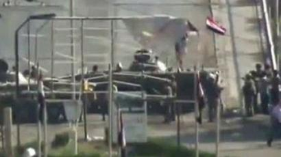 An image grab taken from a video uploaded on YouTube shows Syrian tanks deployed on a bridge in the eastern Syrian city of Deir al-Zor on August 7, 2011 as part of military operations amid a deadly crackdown on anti-regime protests (AFP Photo / Youtube)